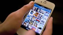 In this Monday, April 9, 2012, file photo, Instagram is demonstrated on an iPhone, in New York. (Karly Domb Sadof/AP)