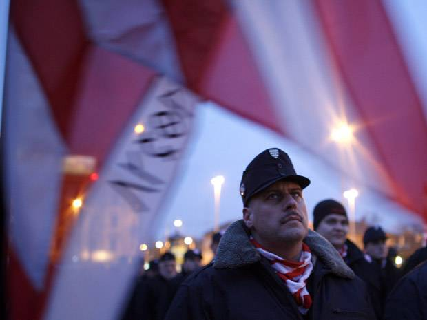 Members of the radical nationalist organization Hungarian Guard attend a rally against a rise of 'Roma crime' in Budapest on Feb. 13, 2009. Although racist violence against Hungarian Roma peaked around 2008-09, according to an Amnesty International report published in January, they continue to experience hate crimes.