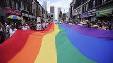 People take part in the annual Pride Parade in Toronto on Sunday, July 3, 2011. (Ian Willms/Ian Willms/CP)