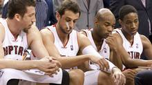Toronto Raptors' Hedo Turkoglu (left to right), Marco Belinelli, Jarret Jack and DeMar DeRozan sit on the bench during second half NBA action against the New York Knicks in Toronto on Wednesday April 14, 2010. (FRANK GUNN/THE CANADIAN PRESS)