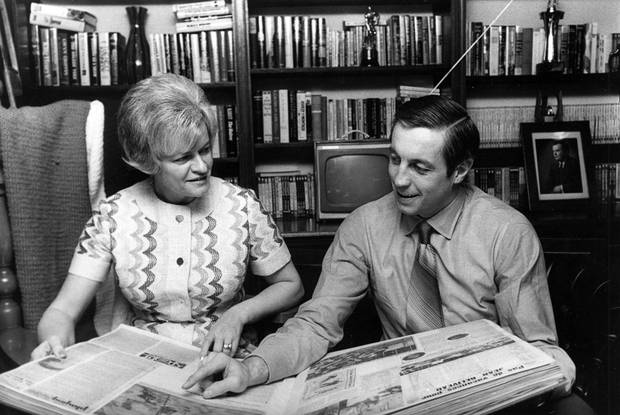 Mme Elise Beliveau goes over some of the highlights of her husband's 18-year NHL career, in Montreal, on March 3, 1971. Former Montreal Canadiens star Jean Beliveau died Tuesday at the age of 83. THE CANADIAN PRESS/UPI