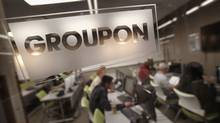 The Groupon logo is engraved in a glass office partition at the company's international headquarters in Chicago. (Scott Olson/SCOTT OLSON/GETTY IMAGES)