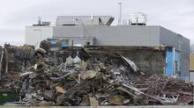 The scene outside Neptune Technologies & Bioressources is shown in Sherbrooke, Que., Friday, November 9, 2012 following an explosion at the plant on Thursday that left two people dead and many more with serious injuries. (Graham Hughes/THE CANADIAN PRESS)