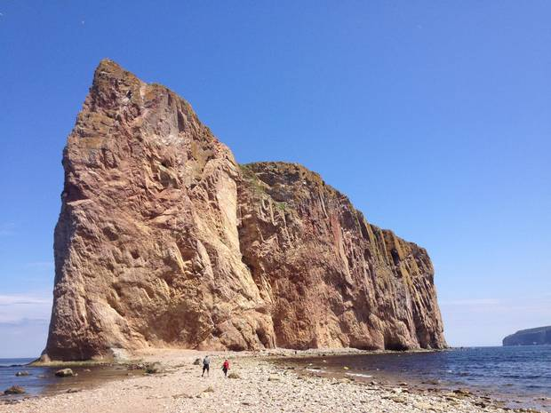 Scooting out to Percé Rock before the tide rolls in.