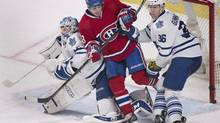 Montreal Canadiens' Daniel Briere, centre, is sandwiched between Toronto Maple Leafs goaltender Jonathan Bernier, left, and Carl Gunnarsson during second period NHL action in Montreal on March 1, 2014. (Graham Hughes/THE CANADIAN PRESS)