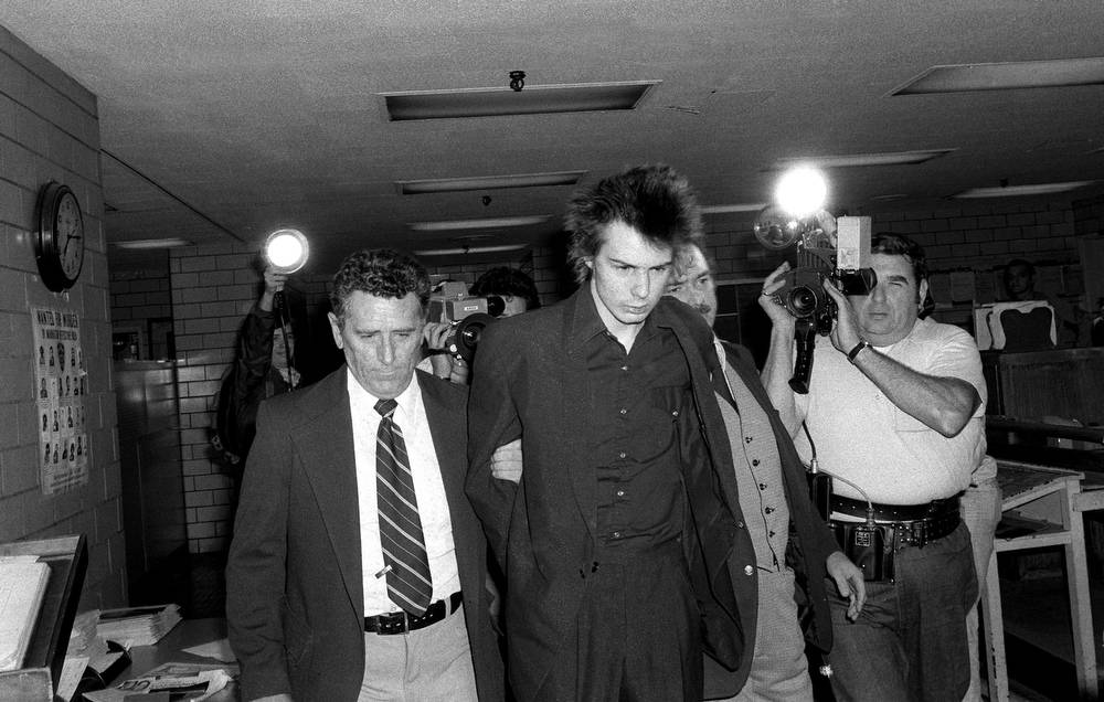 New York police escort Vicious shortly before he was charged with murder in  the stabbing death of his girlfriend, Nancy Laura Spungen, at New York's  Chelsea ...