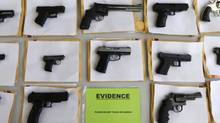 Police displayed some of the nearly 3,400 illegal firearms the have confiscated so far this year in their battle against gun violence. (M. Spencer Green/Associated Press)