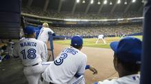 Members of the Blue Jays watch their team face the New York Mets during a pre-season game at the Olympic Stadium Friday, March 28 in Montreal. (Paul Chiasson/THE CANADIAN PRESS)