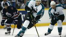 Patrick Marleau #12 of the San Jose Sharks carries the puck up ice against the Edmonton Oilers in game four of the Western Conference Semifinals at Rexall Place on May 12, 2006 in Edmonton, Alberta, Canada. (Photo by Harry How/Getty Images)