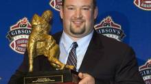 Montreal Alouettes Scott Flory holds his trophy for Outstanding Offensive Lineman at the CFL awards in Montreal on Nov. 20 2008. (Nathan Denette/THE CANADIAN PRESS)