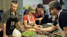 Stop Community Food Centre Founder Nick Saul, volunteer Christina Palassio, volunteer David Protetch and Chef Scott MacNeil prepare lunch at the kitchen of the community centre on Davenport Rd. (Fernando Morales/The Globe and Mail/The Globe and Mail)