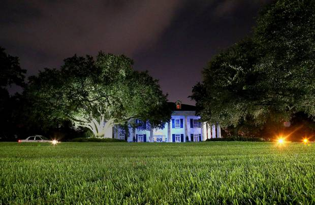 The Louisiana Governor's Mansion is seen lit up with blue lights in honor of the three Baton Rouge police officers shot and killed on July 17, 2016 in Baton Rouge, Louisiana.