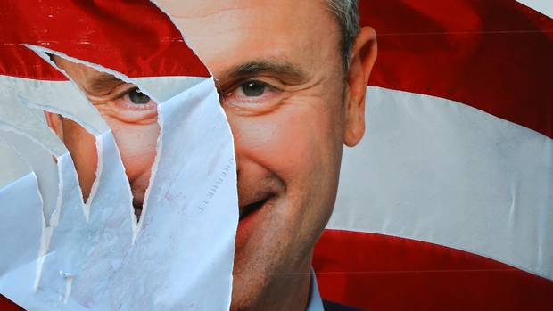 A presidential election campaign poster of Norbert Hofer lies torn in Vienna on Sept. 7. Austrians are re-running their presidential election next month.