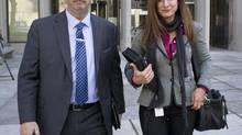 Toronto Police Project Brazen 2 investigators Detective Joyce Schertzer and Detective Sergeant Gary Giroux leave 361 University Courthouse Oct 30, 2013 in Toronto. (Moe Doiron/The Globe and Mail)