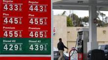 Gasoline prices are displayed on a signboard at a 76 gas station in Encinitas, Calif., February 19, 2013. (MIKE BLAKE/REUTERS)