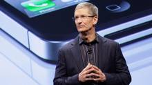 In this file photo taken Jan. 11, 2011, Tim Cook, Chief Operating Officer of Apple, announces that Verizon Wireless will carry Apple's iPhone, in New York. (Mark Lennihan)