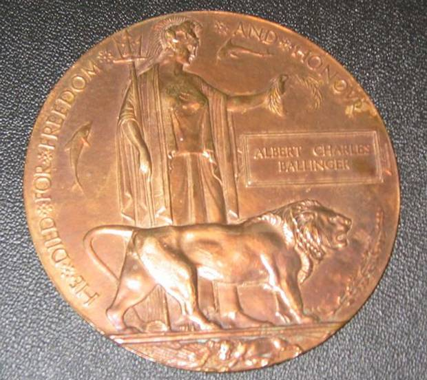 "A memorial plaque, commonly known as a ""death penny,"" honours Private Albert Charles Ballinger, who was killed in the Battle of Hill 70 in 1917."