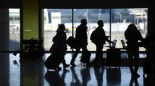 Passengers bring their bags to Toronto's Pearson International Airport on Dec. 30, 2013. (FRED LUM/THE GLOBE AND MAIL)
