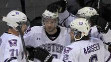 Western Mustangs Kevin Baker (10, middle) celebrates a goal with his team during first period action against the UQTR Patriots at the 2012 Canadian Interuniversity Sport men's hockey championships in Fredericton, New Brunswick. Western won the game 3-2 in overtime. THE CANADIAN PRESS/Mike Dembeck. (Mike Dembeck/CP)