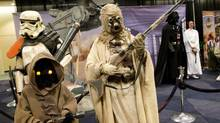 Three Star Wars fans attend FanExpo in Toronto this past August. (Peter Power/The Globe and Mail)