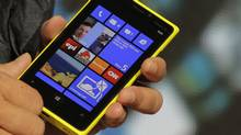 A Nokia executive shows the new Lumia 920 phone with Microsoft's Windows 8 operating system at a launch event in New York, September 5, 2012 (Brendan McDermid/Reuters)