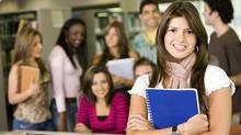 Group of students; woman in foreground. (iStockphoto)