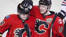 Calgary Flames' Matt Stajan, right, celebrates his goal with teammate Jiri Hudler during second period NHL hockey action in Calgary, Alta., Wednesday, Nov. 27, 2013. (Jeff McIntosh/THE CANADIAN PRESS)