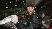 Los Angeles Kings' Matt Greene celebrates with the Stanley Cup in the locker room after the Los Angeles Kings defeated the New Jersey Devils 6-1 in Game Six of the 2012 Stanley Cup Final at the Staples Center in Los Angeles, California June 11, 2012. The Kings won the series 4-2. (POOL/REUTERS)