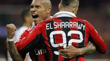 AC Milan's Stephan El Shaarawy is embraced by his team mate Nigel De Jong after scoring against Genoa during their Italian Serie A soccer match at the San Siro stadium in Milan October 27, 2012. (ALESSANDRO GAROFALO/REUTERS)