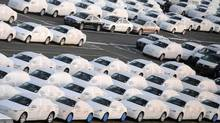 Audi cars are pictured at a shipping terminal in the harbour of the German northern town of Bremerhaven on March 8, 2012. (FABIAN BIMMER/REUTERS)