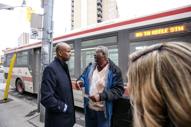 Mr. Hussen talks with a resident on his tour of York South-Weston, one of Canada's most ethnically diverse ridings.