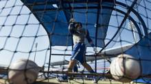 Toronto Blue Jays outfielder Jose Bautista takes part in batting practice during baseball spring training in Dunedin, Fla., on Monday, Feb. 11, 2013. (Nathan Denette/THE CANADIAN PRESS)