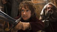 "Martin Freeman, left, and John Callen in a scene from ""The Hobbit: The Desolation of Smaug."" (Mark Pokorny/AP)"