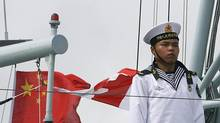 PLA Navy soldiers stand guard during a visit by Chinese President Hu Jintao to the Stonecutters Naval Base in Hong Kong June 30, 2007. (POOL/REUTERS)