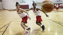 Point guard Kia Nurse (left) of the Canadian women's national basketball team during a practice at the David Braley Centre on the McMaster University campus in Hamilton May 17, 2013. (Moe Doiron/The Globe and Mail)