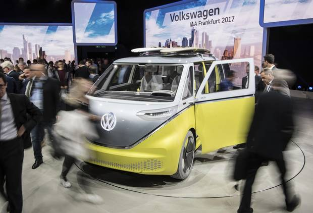 Visitors walk past VW I.D. Buzz on the first media day of the Frankfurt Motor Show IAA in Frankfurt, Germany, Tuesday, Sept. 12, 2017.