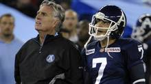 Toronto Argonauts head coach Jim Barker and kicker Noel Prefontaine (R) watch a video replay during the second half of their CFL football game against the Winnipeg Blue Bombers in Toronto September 24, 2011.  (Reuters)