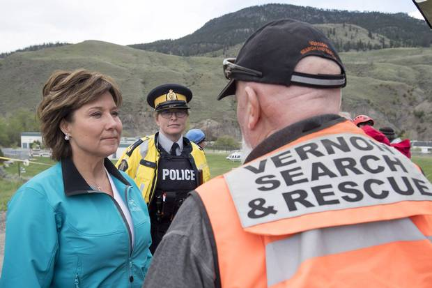 B.C. Premier Christy Clark speaks to a rescue worker as she visits Cache Creek, B.C., on May 6, 2017.