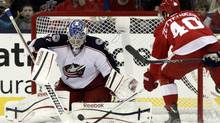 Columbus Blue Jackets goalie Sergi Bobrovsky stops a shot by Detroit Red Wings' Henrik Zetterberg in the second period of an NHL hockey game in Columbus, Ohio, Saturday, March 9, 2013. (Paul Vernon/AP)