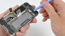A connector on the logic board is removed from the iPhone 4 during iFixit's teardown of the phone in San Luis Obispo, California June 22, 2010. Apple Inc's hot-selling next-generation iPhone sports chips from Samsung Electronics, Micron Technology and STMicroelectronics, according to an early teardown, or disassembly analysis by technology firm iFixit. (iFixit/Handout /Reuters)