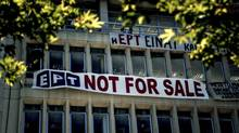 A banner hangs on the facade of the Greek state television broadcaster, ERT, in Athens, Greece, June 18, 2013. While the economic case suggest Greece's exit from the euro zone is off the table, the political argument is another matter. (ANGELOS TZORTZINIS/NYT)