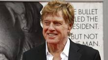 "Robert Redford arrives at Ford's Theatre in Washington last month for the premiere of his film ""The Conspirator."" (Alex Brandon/AP)"
