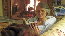Louise Penny reading by the fire. (Gary Matthews)
