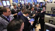 Traders work on the floor of the New York Stock Exchange. (BRENDAN MCDERMID/REUTERS)