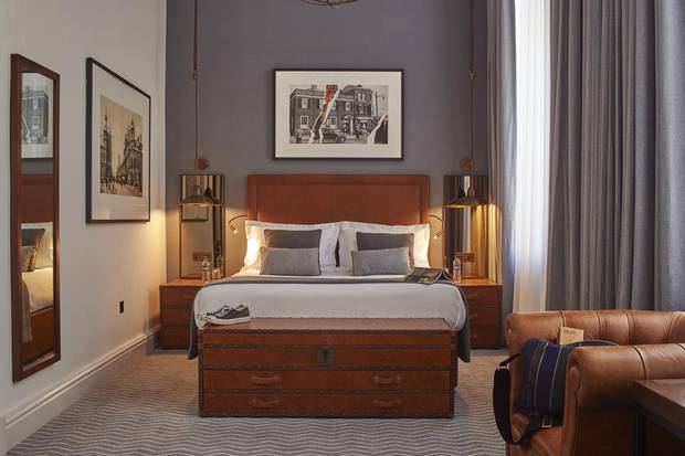 Local architects 3D Reid renovated the sweeping Edwarding structure with designers Michaelis Boyd, amping up the industrial references with iron-mullion mirrors and steel lighting in the hotel's rooms.