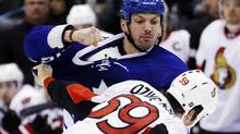 Toronto Maple Leafs' Frazer McLaren, left, fights with Ottawa Senators' David Dziurzynski during the first period of their NHL hockey game in Toronto, March 6, 2013. Dziurzynski left the ice after the fight. (Mark Blinch/REUTERS)