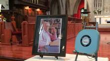 A videocassette case containing the ashes of former CBC anchor Knowlton Nash sits beside his portrait at his funeral in Toronto on Wednesday, May 28, 2014. (Ioanna Roumeliotis/THE CANADIAN PRESS)