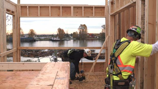 A project under construction by the Vancouver Community Land Trust Foundation is seen along the Fraser River in Vancouver.