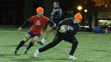 Liam Underwood(blue shirt) for Queen's University men rugby team, runs with the ball during practice on Nixon field in Kingston, Ont., on Thursday Nov. 7, 2012. Queen's is meeting Western in the OUA final on Sunday Nov. 11, 2012. (Lars Hagberg For The Globe and Mail)