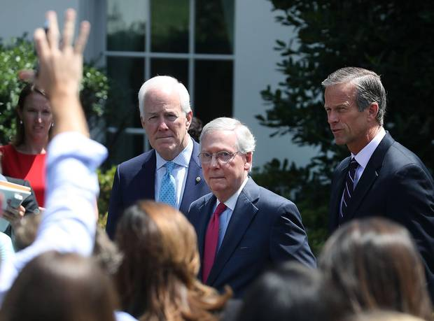 Senate Majority Leader Mitch McConnell (centre), Sen. John Thune (right), and Sen. John Cornyn (left), speak to the media. McConnell could not find a way to bridge a divide between senators on the health-care bill.